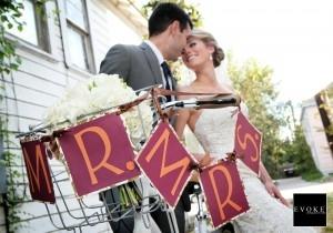 A bride on a bike in her wedding dress