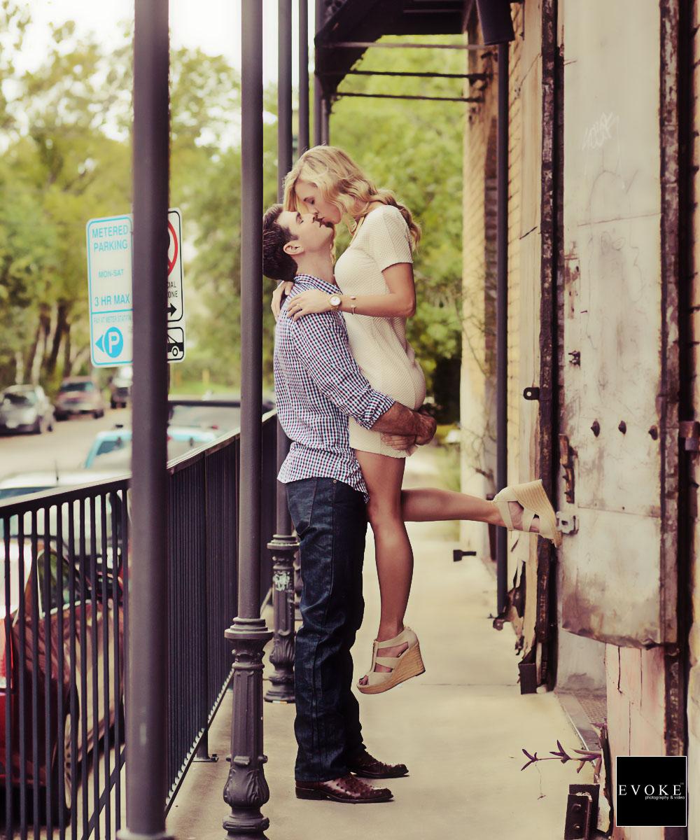 Elevated kiss on the balcony at Dakota Lofts.