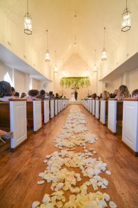 The happy couple had flower petals cover the chapel's aisle