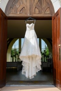 A wedding dress hangs before the chapel for us to admire