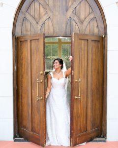 The bride opens the chapel doors in excitement