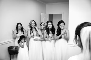 The bridesmaids see their blushing bride for the first time