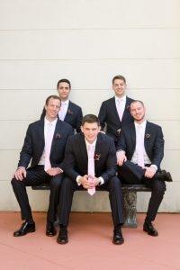 The groom flanked by his groomsmen