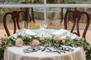 Fun and sweet decor for the head table at the wedding reception
