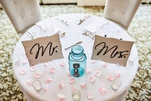 Sweet decorations to mark the head table at the wedding reception