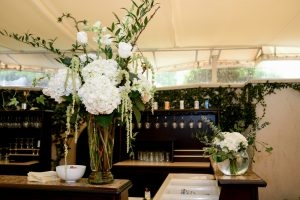 The wedding reception bar is filled with the groom's favorite beers