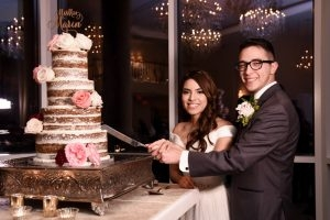 The bride and groom cut their wedding cake