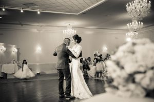 The father-daughter dance at the wedding reception