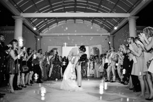 Bubbles lead the bride and groom to their wedding exit