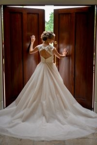 The bride poses in the chapel prior to the ceremony