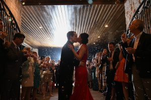 Bubbles blown at the couple as they exit the reception