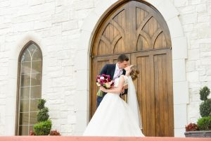 The couple's first kiss outside the wedding chapel