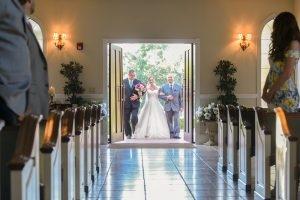 The bride enters the chapel