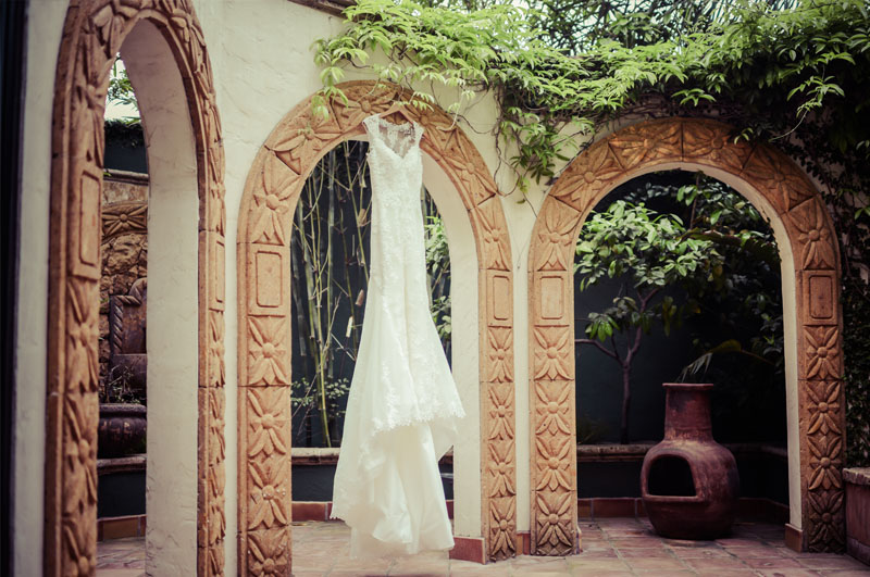 A wedding dress hangs in the Bridal Courtyard at the Bell Tower on 34th