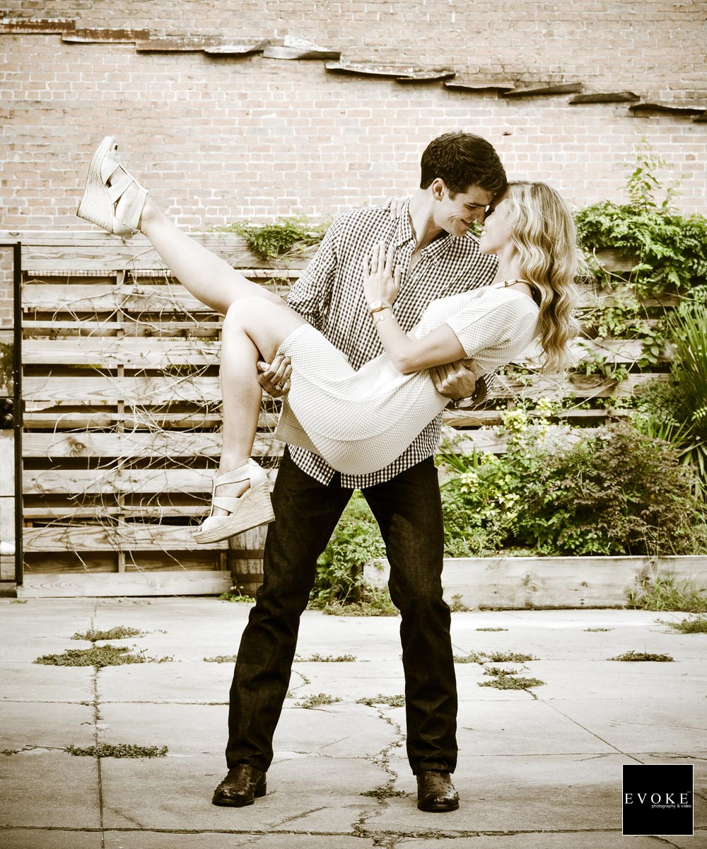 Sepia toned image of engagement session at Dakota Lofts.