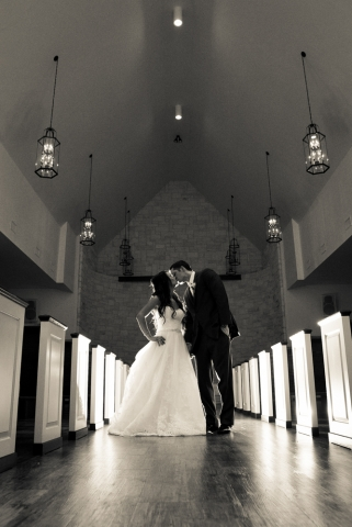 The bride and groom take an intimate moment in the wedding chapel