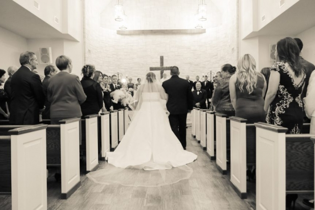 Dad walks the bride down the aisle