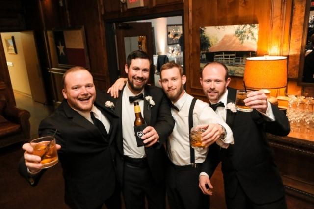 The groomsmen toast to the happy couple