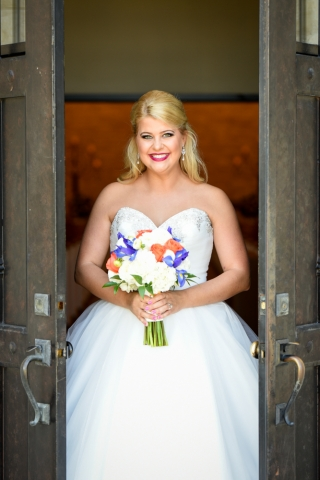 A blushing bride poses for the camera