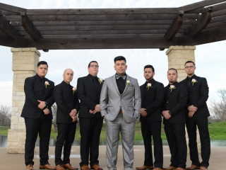 Hip groomsmen pose for a portrait