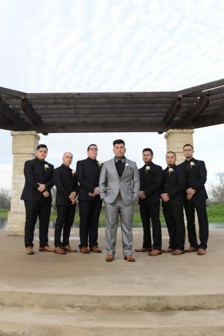 Hip groomsmen pose for a portrait