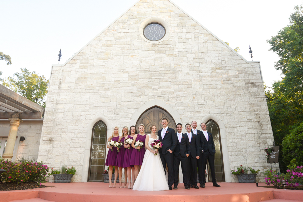 The bridal party poses for a group portrait outside the chapel