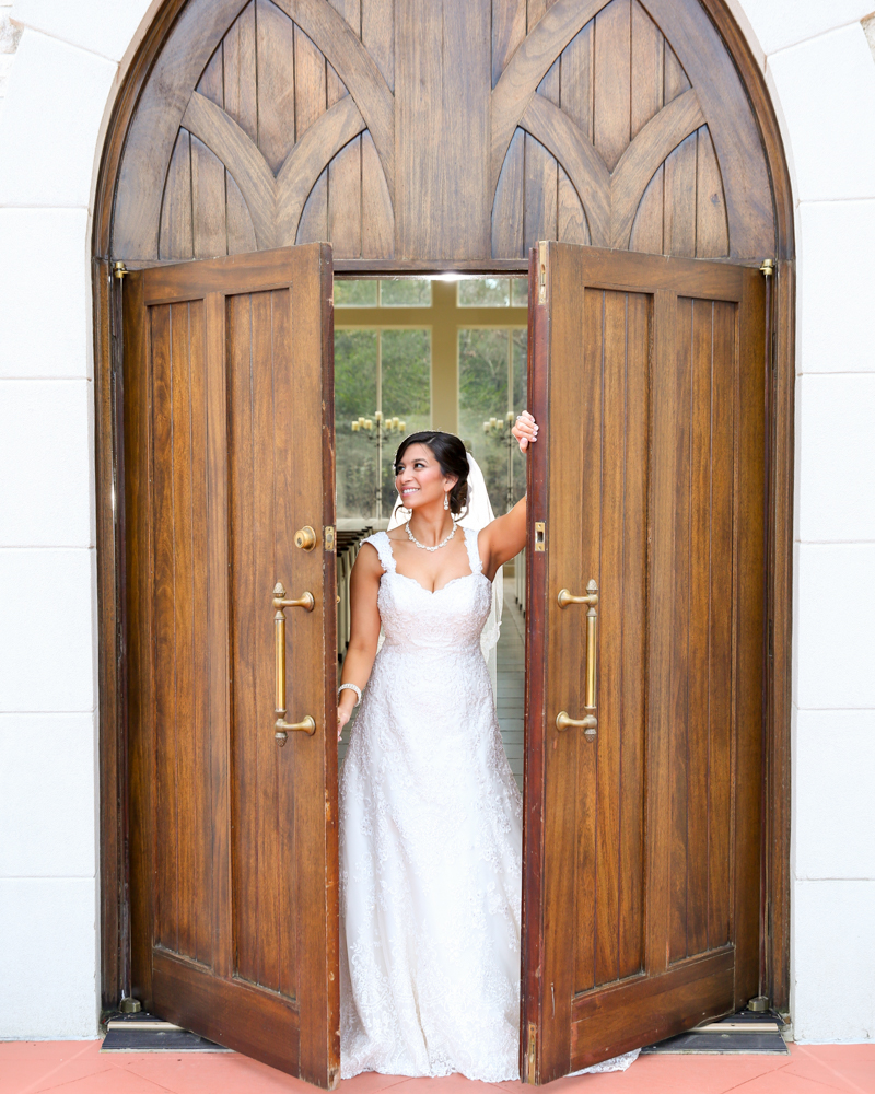 The bride opens the chapel doors in excitement
