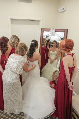 The bridal party helps the bride get ready