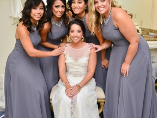 The bridal party poses for a portrait in the bridal suite