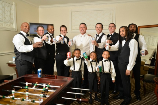 The groomsmen cheers to the excitement of happily ever after