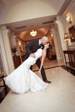 The couple takes a private kiss outside the reception