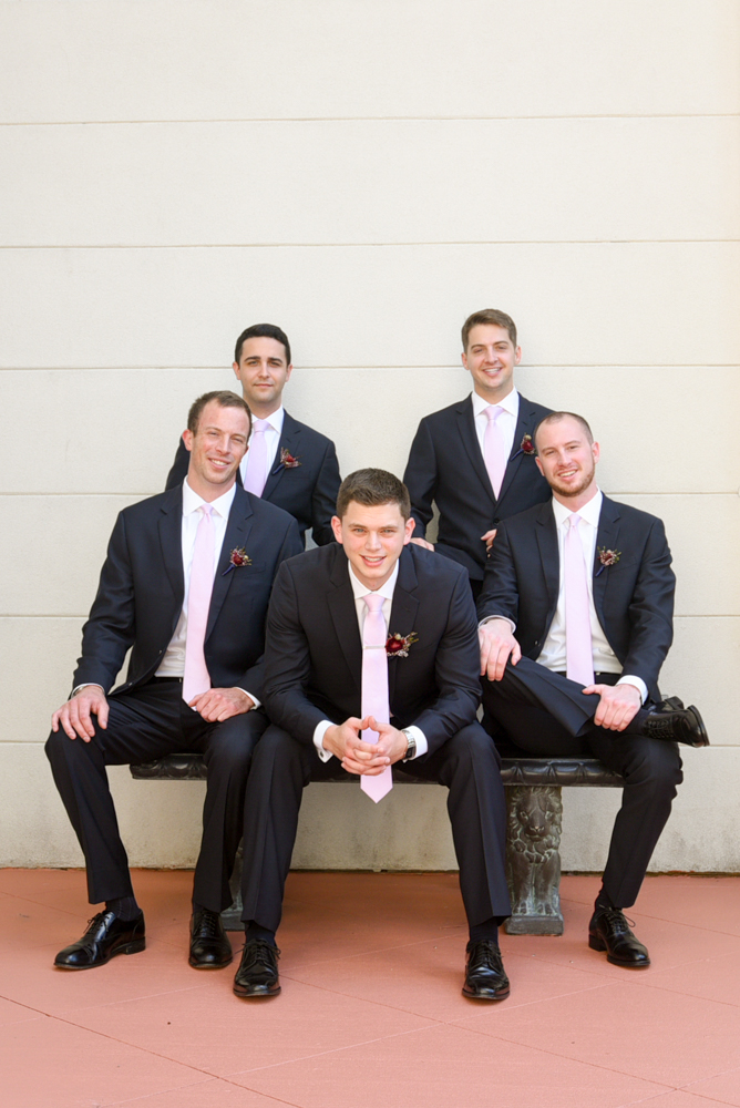 The groom flanked by his groomsmen