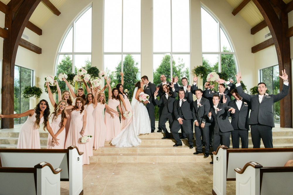 An excited wedding party celebrates the love of the new Mr. and Mrs.