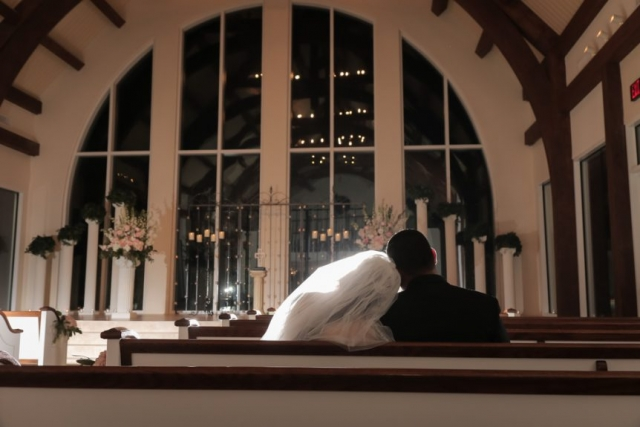 The couple takes a moment together post wedding ceremony