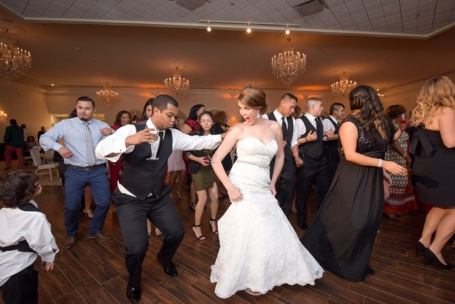 The bride and groom enjoy the group dance