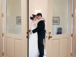 The couple takes an intimate moment outside the wedding reception