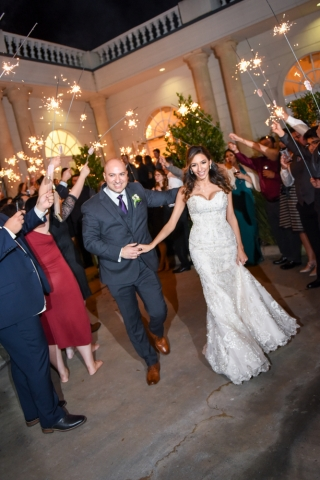 Sparklers lead the way during this wedding exit
