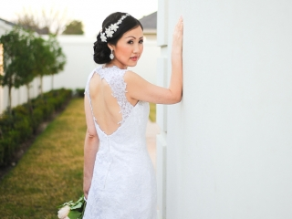 A beautiful bride poses outside the wedding venue