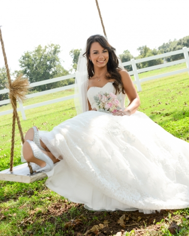 A bride taking a swing on the Big Day