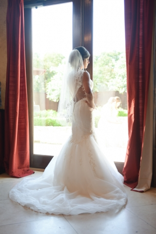 A reflecting bride poses before the start of the ceremony
