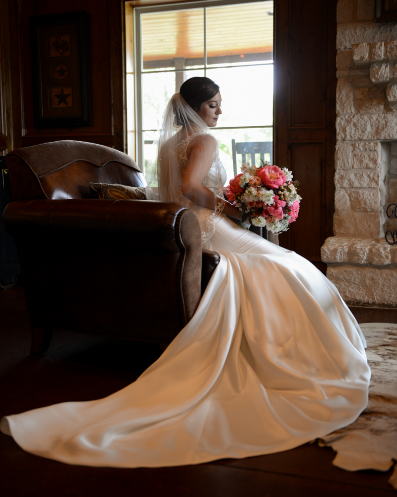 A meditative bride poses for a portrait