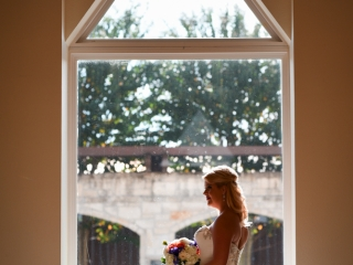 The bride poses for a portrait inside the wedding chapel