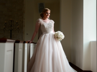 A beaming bride on her wedding day