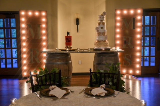 Wedding and groom's cake displayed with a rustic theme