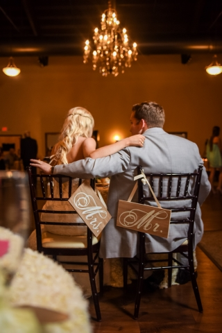 The bride and groom enjoy their first meal as husband and wife