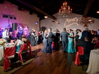 Formally dressed wedding guests have a dance