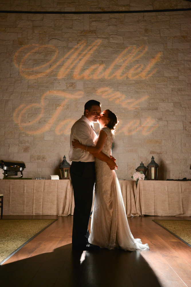 A sweet kiss on the cheek during the couple's First Dance