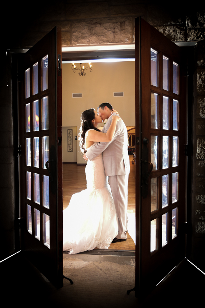 The doors are open to a new life together as the couple kisses
