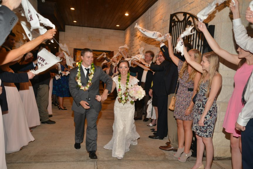 The couple make an exit as guests cheer them on