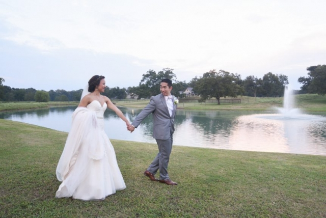 A wedding day stroll next to the lake
